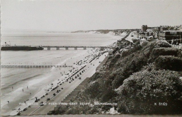 Vintage postcard of The Beach and Pier from East Cliff, Bournemouth